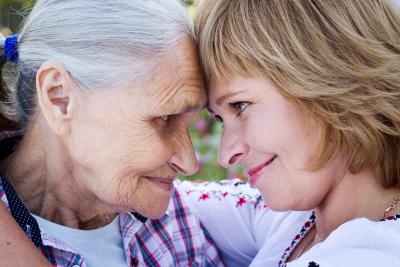 woman and senior woman hugging